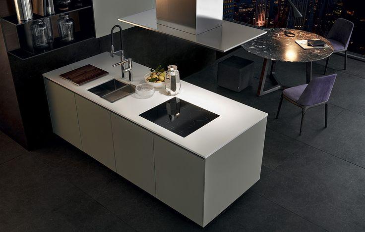 Varenna_Alea kitchen with creta embossed lacquered base units, worktop in superwhite micro-blasted quartzite. Island-hood in steel.