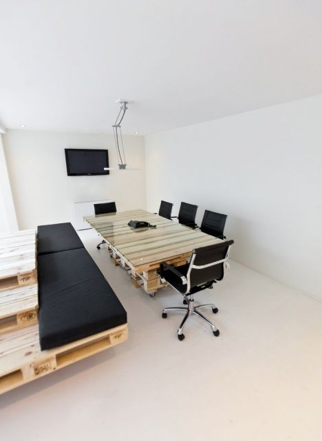 "Office Conference Table and ""cushioned bench"" made from wood shipping pallets"