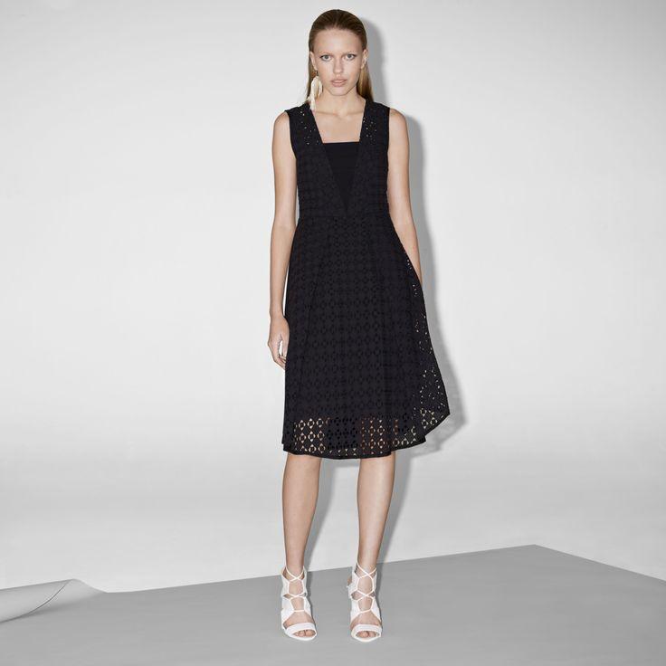FWSS Paprika Expose is a feminine, crisp cotton dress with lace panels, a fitted waist and a flared skirt.  http://fallwinterspringsummer.com/