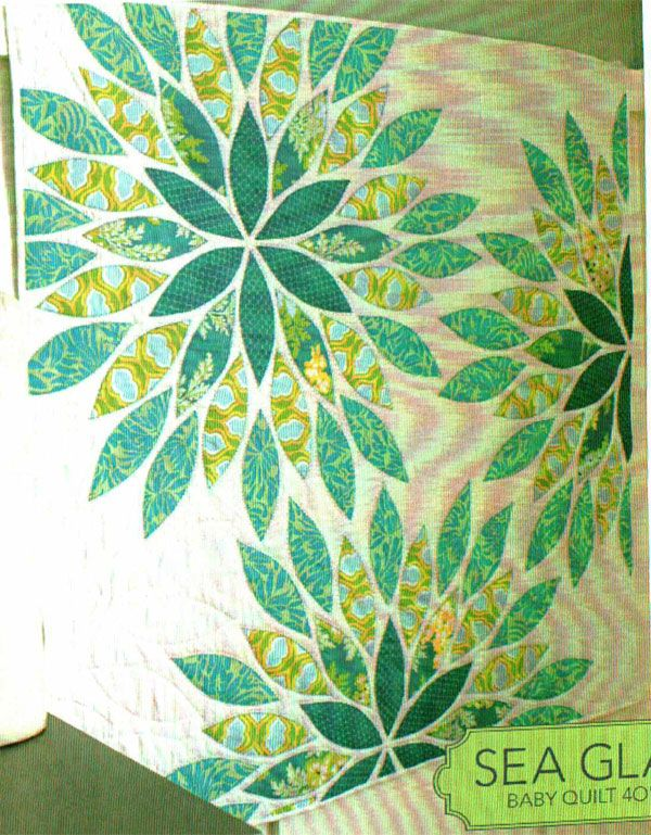 Sea Glass Quilt Pattern by Talk of the Town at KayeWood.com. A soft and vibrant quilt to wrap a baby in, use for a toddlers lap quilt or hang on your wall as an art display. Easy to put together with beautiful fabric and contrasting hand quilted stitching giving your quilt a beautiful handmade touch. http://www.kayewood.com/item/Sea_Glass_Quilt_Pattern/3902 $10.00