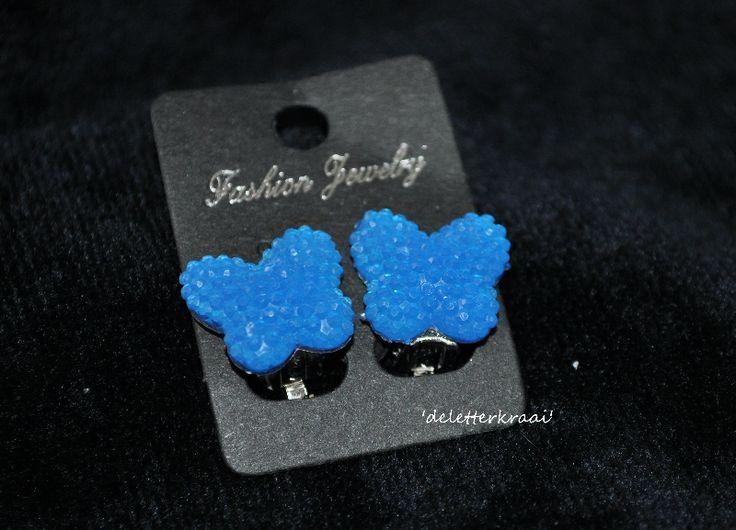 Vlinder NEON blauw klem oorbellen