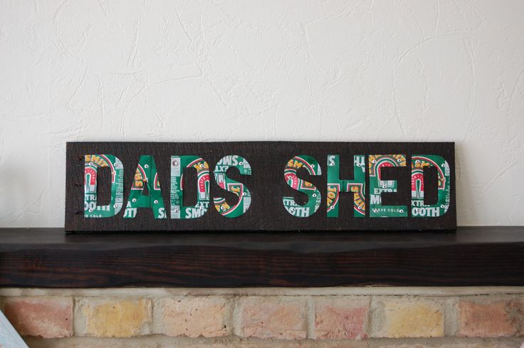 A sign for the brother in laws shed hand made from used pallet wood stained in walnut with letters hand cut from used aluminium John Smiths drinks cans hand riveted