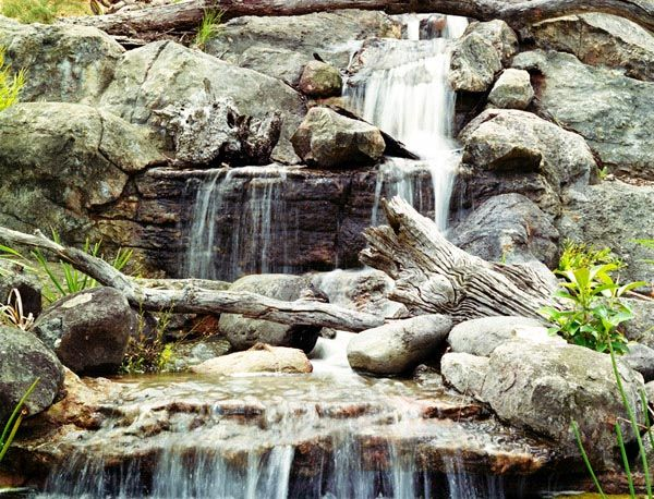Fake rock water featurewaterfall pinterest rock for Artificial water pond