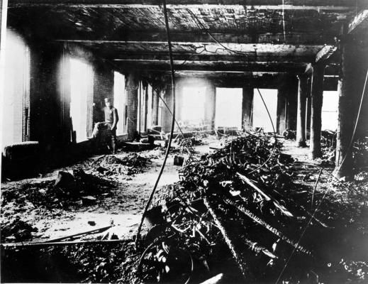 A police officer surveys the damage after the Triangle Shirtwaist Factory fire on March 25, 1911, in New York, New York.