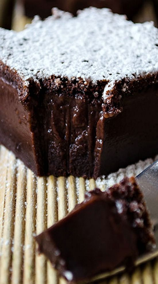 Chocolate Magic Custard Cake with a very soft center. It might crack when slicing, but this makes the cake even more tempting! This will be your ultimate celebration cake! Don't worry about the liquidy batter, it will bake up perfectly!