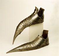 Steel sabatons, German, c. 1490's. Part of a complete suit of armor.