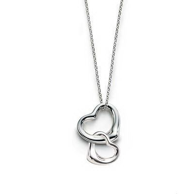 Tiffany & Co Double Open Heart Necklace~My mother bought me one similar to this one,but mine has a diamond in it and the box Said.A mother will always hold her daughters. heart and soul forever.it hangs in my car for now.