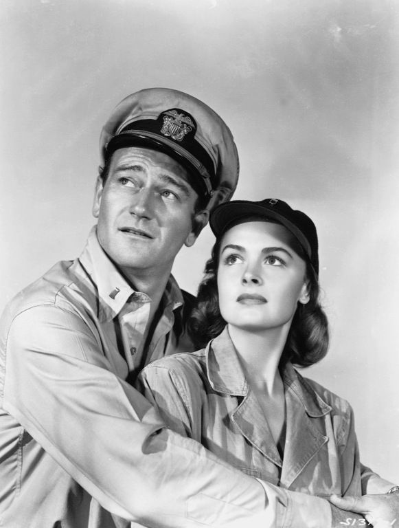 dedicatedtoduke:  Duke with Donna Reed. They Were Expendable, 1945. According to Caroline McGivern biography on JW, it was on the set of this movie that Duke started dreaming about directing his own film about duty and sacrifice, The Alamo.