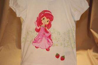 Hand painted t shirt | I use non-toxic, water based, permanent fabric colors. | My daughter used to love Strawberry Shortcake when she was little. I painted this for her, about five years ago, when I first started painting on t-shirts.