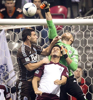 Vancouver Whitecaps 1- Colorado Rapids Colorado Rapids goalkeeper Matt Pickens, right, punches the ball away from Vancouver Whitecaps' Martin Bonjour, left, of Argentina, as Rapids' Edu,defends during the first half.    The Canadian Press, Darryl Dyck - A
