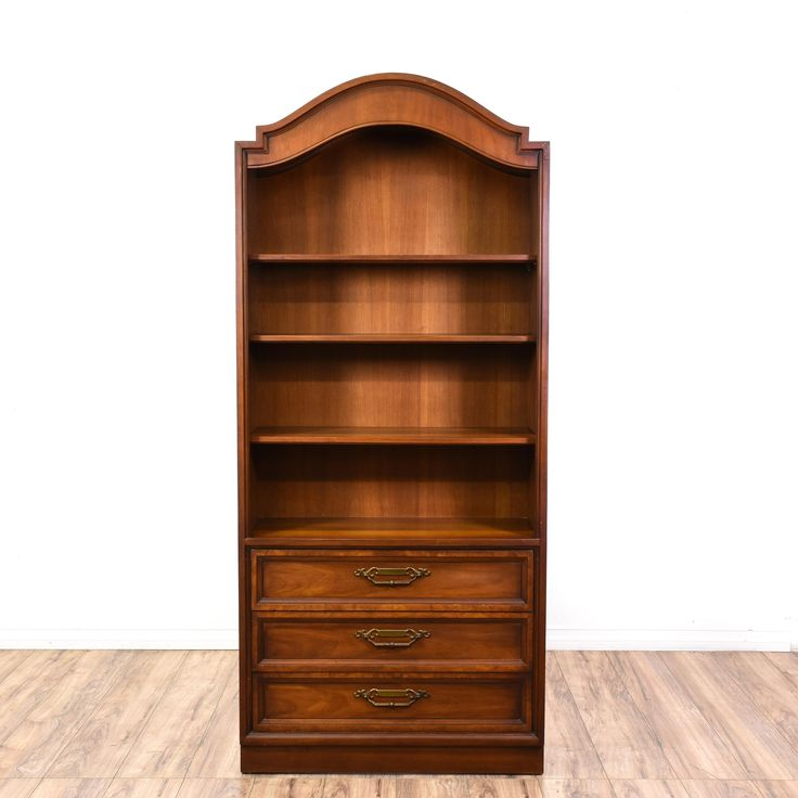 "This ""Drexel"" bookcase is featured in a solid wood with a glossy cherry finish. This American mid century bookshelf has 3 flat drawers, dovetailed joinery, and carved trim. Perfect for organizing your home library! #americantraditional #storage #bookcase&shelving #sandiegovintage #vintagefurniture"