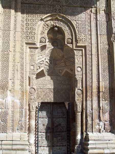 Divriği - Ulu cami. The famous praying man shadow at the side door of the mosque.