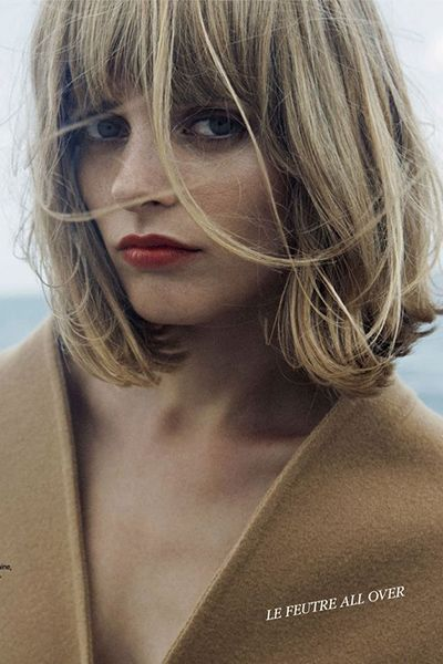 If you've always wanted to channel a Nouvelle Vague ingenue, look no further than this blunt-cut bob with long, layered bangs.