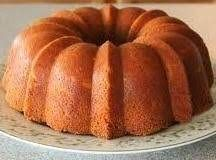 This is some serious pound cake - heavy, dense and delicious. Change it up by omitting the lemon extract, or substitute 1/4 to 1/2 teaspoon almond extract for the lemon. Iced with any powdered sugar glaze you like or plain, this cake is addicting.