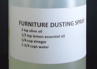 HOME MADE FURNITURE DUSTING SPRAY 2 teaspoons olive oil 1/2 teaspoon lemon essential oil 1/4 cup white vinegar 1-3/4 cups water Spray bottle (16 oz size or larger) Mix the ingredients in the order listed into your clean spray bottle. Shake well to mix. Spray onto wooden furniture and wipe off with a soft cloth to dust and clean the surface.: