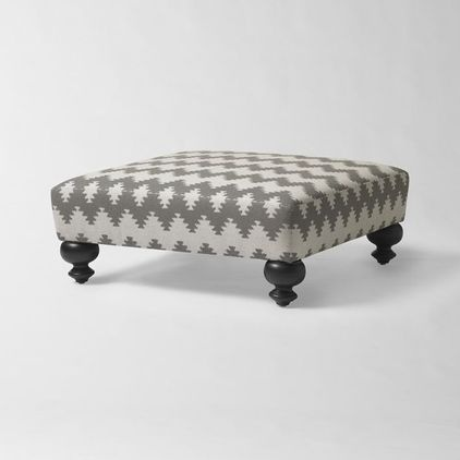 This could be a DIY with a pallet and small wooden feet from a home improvement store and some fabric and stuffing! Great contemporary ottomans and cubes by West Elm