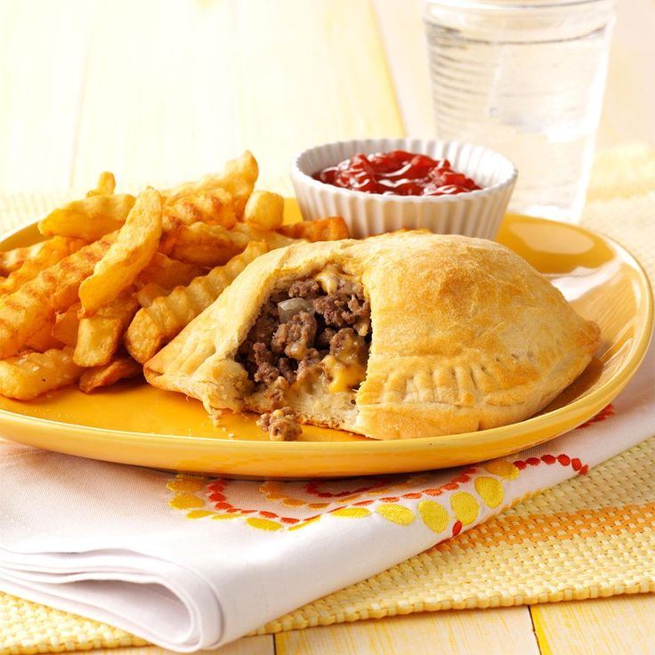 Cheeseburger Pockets Recipe -Ground beef is my favorite meat to cook with because it's so versatile, flavorful and economical. Refrigerated biscuits save you the trouble of making dough from scratch.—Pat Chambless, Crowder, Oklahoma