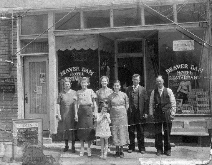 Beaver Dam Cafe.  It started out life as the Beaver Dam Hotel and Restaurant. The hotel was upstairs. Most of the rooms still have the small cast iron sinks on the wall as they did not each have a private bath. Noticed the Sterling Beer sign in the window, There use to be a liquor story in Hartford. Left to right. - Ethel Bivens, EJ Knight, Tootsie Givens ( in the back), Betty Dale. The little girl in front would probably be Louise Evans or possibly Lucy Revelet