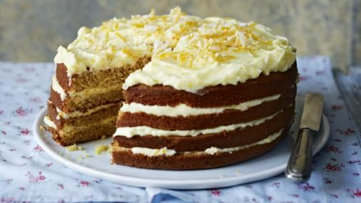 A whole orange is boiled and puréed to make a rich marmalade-y cake which is lightly spiced and decorated with curls of orange rind. Add a little more spice if you want it to be very spicy.