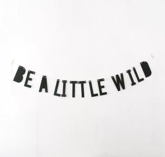 A paper word banner is the perfect way to make a bold statement! This one says BE A LITTLE WILD and would look cute in a childs bedroom or