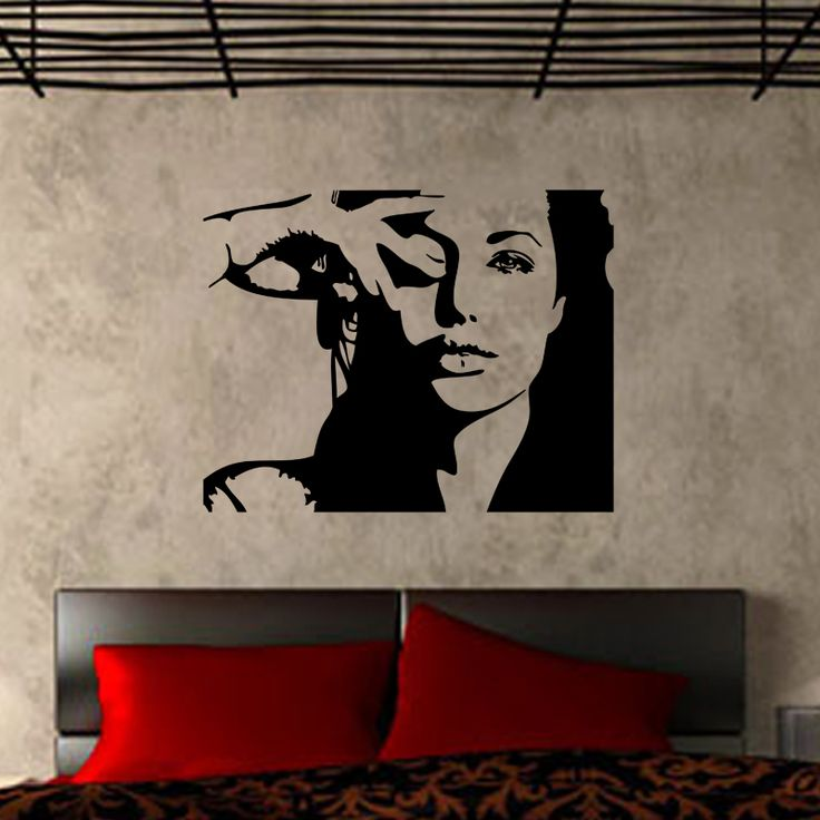 Angelina Jolie Portrait Wall Decal  Make your walls come alive with this stunning Angelina Jolie Portrait Wall Decal. Give any wall a fresh new face with this beautiful Angelina Jolie Portrait Wall Decal. This decal features Jolie with a mysterious, seductive gaze that will make any film fan smile. Sleek, modern, and sexy, this decal is the perfect finishing detail for a studio, salon, or home space.