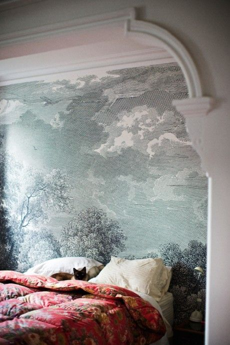 Wall mural and rich, textural bedding. Wonderful.
