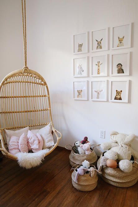 sweet nursery with animal prints and a hanging chair