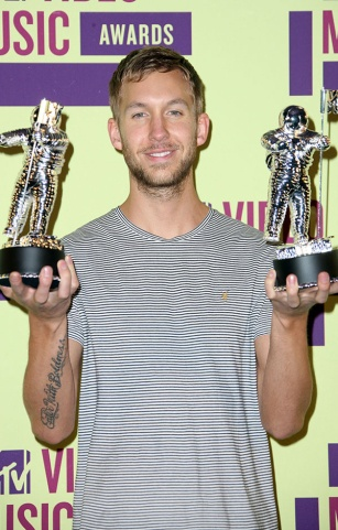 Calvin Harris photographed with his Moonmen for Best Electronic Dance Music Video and for his featured role on Rihanna's Video Of The Year winner 'We Found Love.'