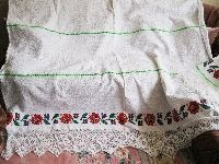 A superb 100 % hand woven cotton on hemp bed sheet  with hand made lace from Transylvania . Available at www.greatblouses.com