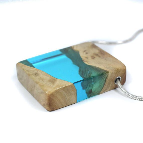 A stunning wood and blue resin necklace from ArtfulResin, handmade by me in Kent, United Kingdom. This minimal necklace is a fusion of burl wood and ocean blue resin. It is a lovely, one of a kind resin wood pendant that would make a unique gift for her. This blue necklace would add art