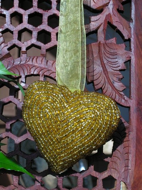 Indian beaded heart decoration in gold. http://www.maroque.co.uk/showitem.aspx?id=ENT02859&p=06506&n=all