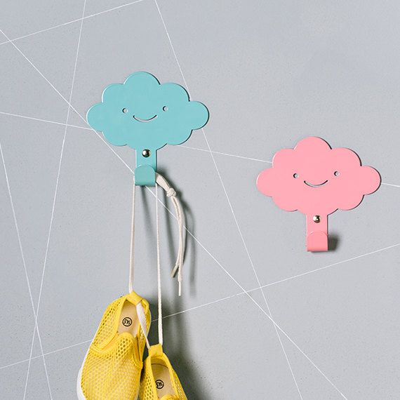 These smiling cloud wall hangers are just what you need to add some functional style to your little ones room. Whether you are decorating a nursery, a
