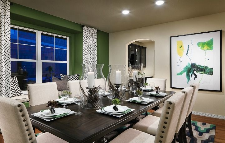 Do you LOVE the green accent wall in this @lennarcolorado dining space?