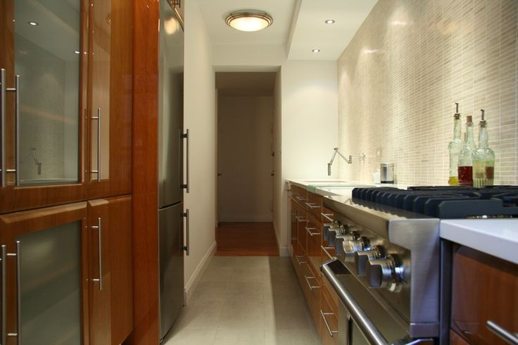 Small galley NYC kitchen glass doors