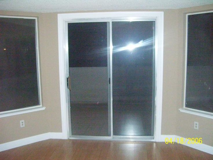 put bright white trim around sliding glass door for a