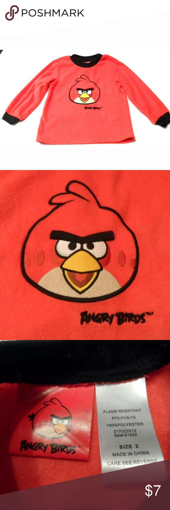 """Unisex Toddler Shirt Angry Birds size 2 Unisex toddler 100% polyester long sleeve shirt, size 2. Measures approx. 14"""" long from shoulder to hem.. Measures approx. 13"""" wide @ chest from armpit to armpit. Sleeves measure approx. 9"""" long from directly under armpit. Item has been pre-owned;  I do not find any stains, rips or odors. ** Coming to you from a smoke-free home.  ?? I have 100% positive feedback on my other selling channel...please see link inside profile. Angry Birds Shirts & Tops…"""