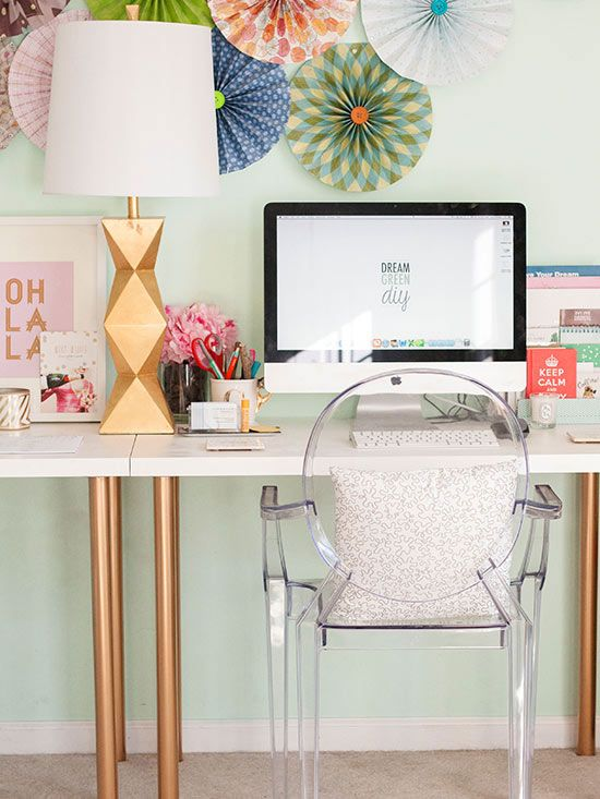 A spritz of gold paint turned two desks with mismatched legs into a chic work space for Carrie of Dream Green DIY. We never would've guessed they originally came from the As Is section of IKEA! Get all the details at Dream Green DIY.