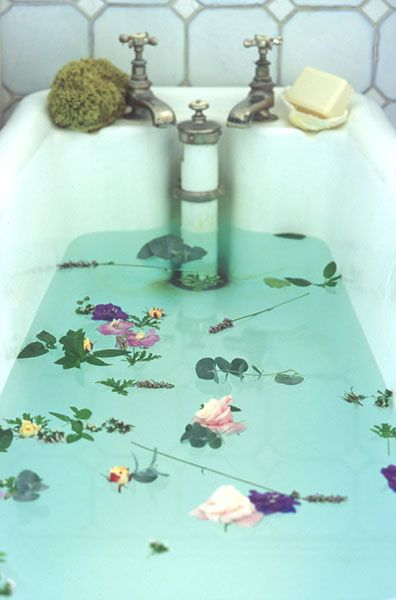 Cool blue water with flowers in your bath...yes, please!! *wink*