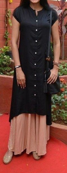 A lovely plain and perfect outfit. Black kurta and flared palazzo s