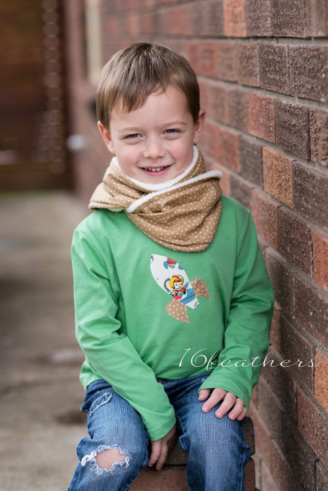 The perfect winter accessory for your little people! These gorgeous handmade scarves feature the soft of softest fleece on the inside and trendy cotton fabrics on the outside! So cosy and lightweight - they are best way to keep them warm this winter.Each is finished with a vintage button or choose to keep them plain. Fits Child size approx 3-12 years.Team with other items from the @Sydney Smith clothing range.