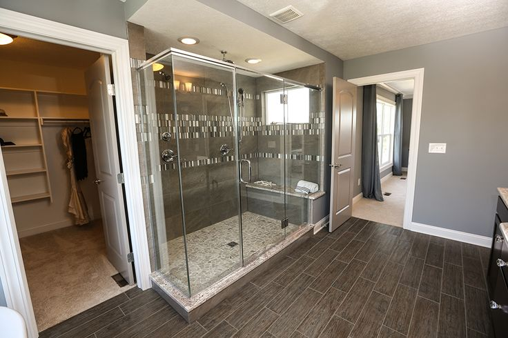 Shower and Master Closet #shower #master #bathroom #bedroom #closet #oversized #upgraded #wood #shelving #flooring #tile #wood #design #interior #glass #surround #custom #poured #bench #windows #sherwin #williams #painted #doors #lighting #jerome #village #plain #city #ohio #dublin #schools #luxury #dream #home #model #3 #pillar #homes #real #estate #builder