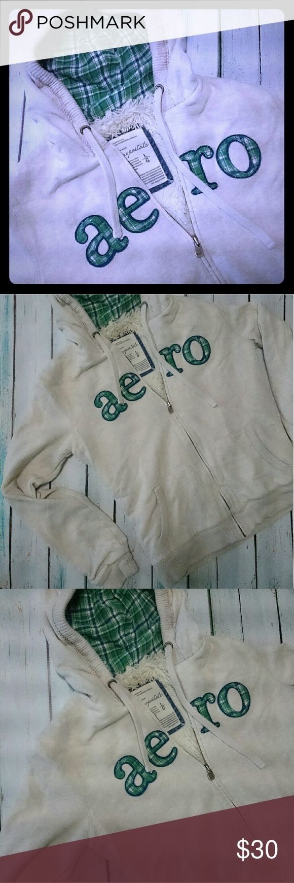 """Aero Zip Up Hoodie Very thick and warm, faux fur hoodie from Aeropostale. Oatmeal/beige with green plaid """"Aero"""" on front and green plaid on the inside of the hood. Full zip. EUC. No flaws or stains. Aeropostale Tops Sweatshirts & Hoodies"""