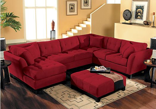 Upscale design meets casual living in the Cindy Crawford Home Metropolis Cardinal 4-Piece Sectional Living room with decorative tufting. Features 3-piece sectional and matching tufted ottoman.