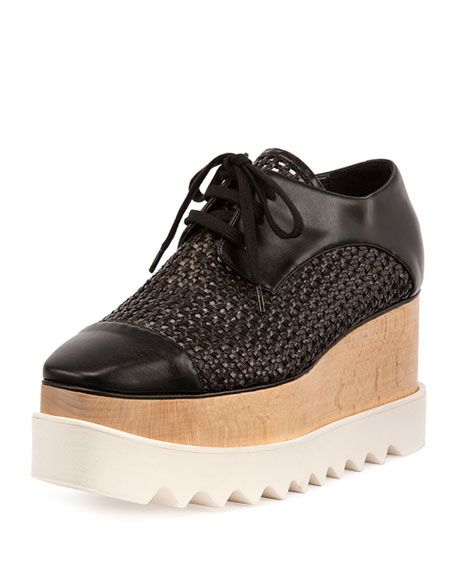 "Stella McCartney woven faux-leather (polyurethane/polyester/cotton) sneaker. 3"" wooden platform heel. Round cap toe. Lace-up front. Rubber outsole. ""Elyse"" is made in Italy."