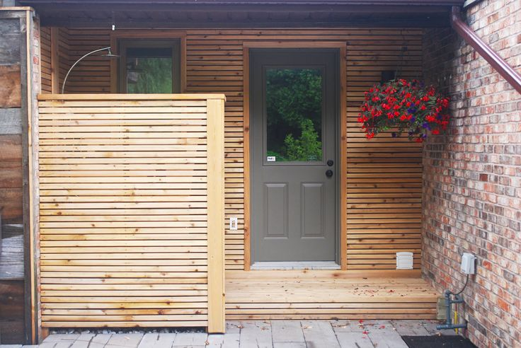 Ripped horizontal cedar boards to close in this outdoor shower and frame the entrance