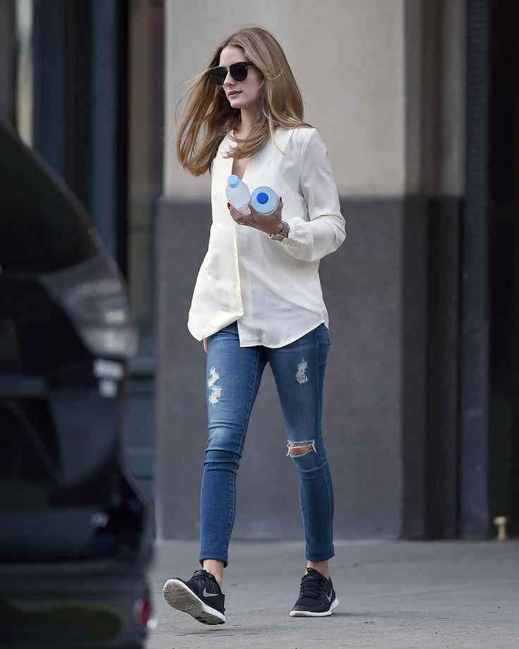 Olivia Palerom Summer street style inspiration: Yes, even Olivia opts for jeans and sneakers sometimes. A structured blouse helped give the look that fashion touch while distressed denim and nike running sneakers are casual enough for a day of errands.