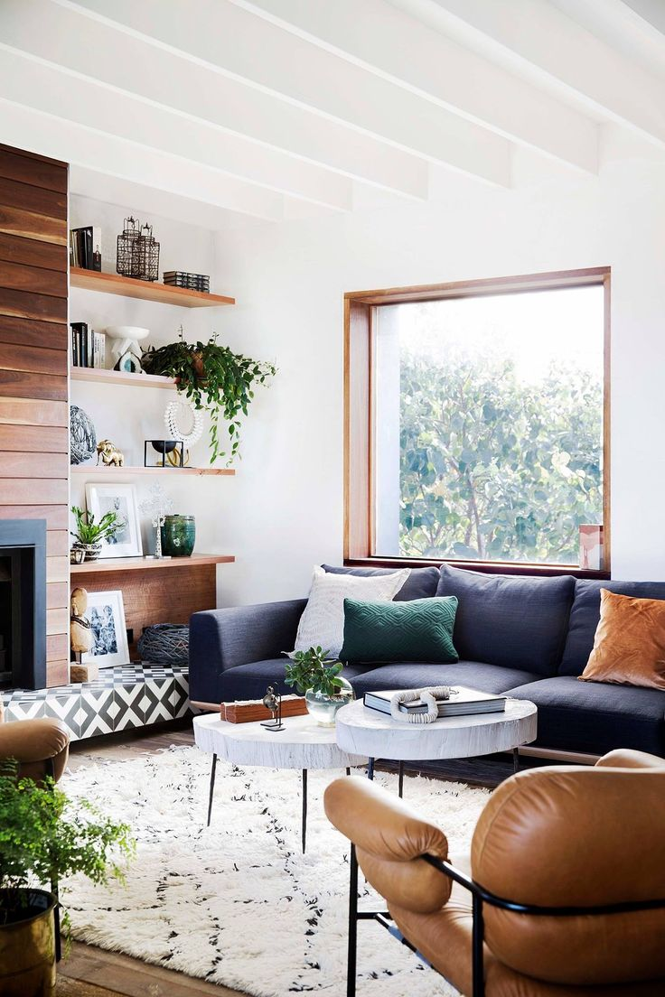 Living room ideas, leather chairs, gray sofa. wood fireplace