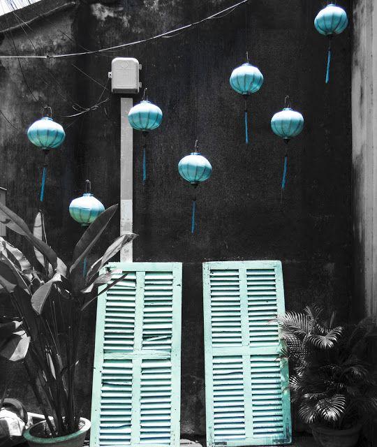 Blue lanterns and shutters in Hoi An Vietnam