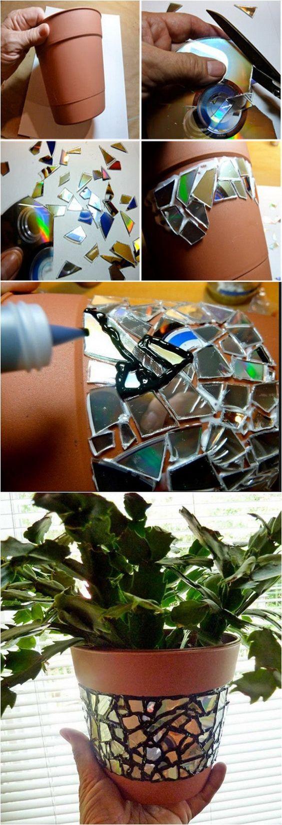 Recycled CD Mosaic Flower Pot. Ever got a stock of useless CDs? Don't throw them away! Make a beautiful CD mosaic flower pot instead.