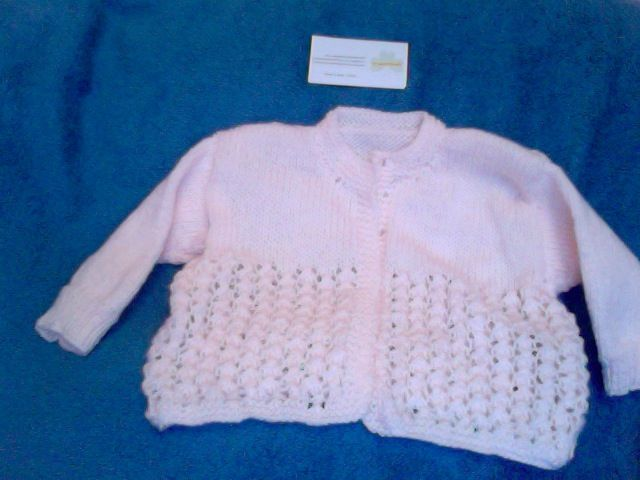 Beautiful Irish Hand Knitted Coral, Soft Acrylic Cardigan, 4 button top, size 3-9months. Be First with this season's colour, email thecraftyshamrock@gmail.com